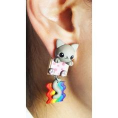 Earring inspired in Nyan Cat simulating to goes through the ear, this design is completely handmade and the composition is polymer clay Polymer Clay Kawaii, Polymer Clay Charms, Polymer Clay Earrings, Nyan Cat, Animal Earrings, Cute Earrings, Kawaii Jewelry, Cute Jewelry, Diy Clay