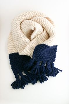 Hygge - Keep your neck warm and toasty with this easy tasseled garter stitch color block scarf. Blue and cream, easy quick scarf!