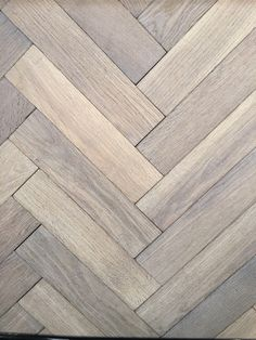 Our Antique Grey Oak Herringbone goes through a special organic treatment to achieve a Mid Century Aged patina. It took us several years to achieve the perfect balance between the white weathered texture and the grey and sandy colour variations. We also supply this Antique Gery Herringbone Parquet with a lightertone at the same price.
