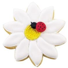 Make every detail count. Piped-icing insects and Color Flow Icing turn daisy cookies perennially charming.  Ingredients: