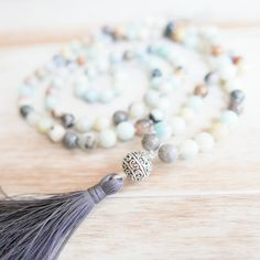 """The Stone of Courage & Truth. Amazonite represents the Throat Chakra and encourages us to """"Speak Our Truth"""". Amazonite encourages clear communication and supports in healing the throat and thyroid. This 108 bead Mala Necklace is made in the traditional fashion with hand-tied knots between each bead."""
