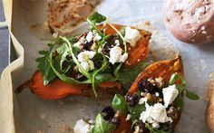 Baked sweet potato with rocket, black olive and walnut relish and goat's cheese - http://www.thewednesdaychef.com/the_wednesday_chef/2013/02/roasted-sweet-potatoes-with-spicy-feta-olive-salad.html
