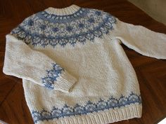 Traditional unisex Icelandic Lopi sweater worked in the round with colorwork details.