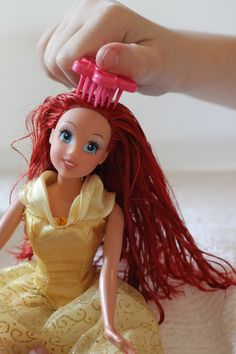 "How to Fix Barbie Friz:  The first step is to brush barbies hair the best that you can.  Then simply ""dunk"" her hair in really hot water for about 30 seconds and towel dry."