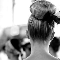 high bun and tulle bow
