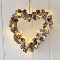 Charming hanging decoration for all year round enjoyment.Wonderfully natural heart shaped wreath of compact pinecones with the effect of a lovely fine dusting of snow. Create a stylish internal door or above mantlepiece decoration by hanging with the twine provided. Enhance your wreath by illuminating it with our Copper Wire Battery Garland by simply entwining the wire around the pinecones. The 24 warm white LED garland can be set to either static or twinkling mode so makes an enchanting…