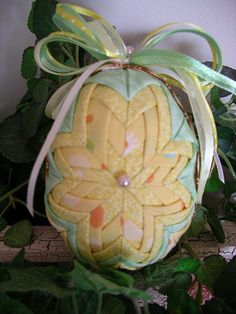 This quilted folded fabric Easter Egg has basket weave fabric trim.  Perfect to hang on an Easter Tree, or lay in a basket either side up.  Fabric