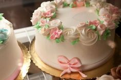 Just a really pretty, old fashioned cake, in feminine colors, with buttercream flowers and ribbon.