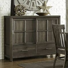 Featuring a sliding door and 2 drawers, this chic sideboard offers ample storage space for table linens and flatware in the dining room or spare blankets in your master suite. @Tender Love & Paint