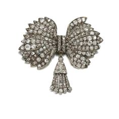 DIAMOND BROOCH, EARLY 19TH CENTURY, COMPOSITE Designed as a bow suspending a tassel, set with cushion-shaped, circular-cut and rose diamonds, later brooch pin.