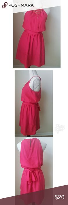 Pink dress by Express Shell 100% polyester Lining 95% polyester 5% spandex  Length from shoulder down approx 34 inches To see more measurement see images  The dress has a bottom on the back of it Dress is excellent condition  Reasonable offer accepted Express Dresses