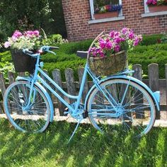 Blue bicycles with pink flowers.