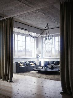 Love the concept of defining spaces and creating temporary walls with heavy curtains.