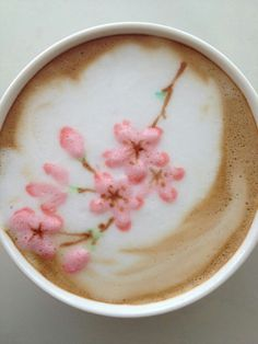 Sakura in my cup. (But what exactly is the rose-coloured stuff?!)