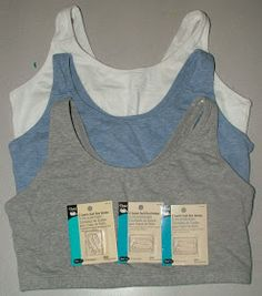 All Twisted Up: Sports Bra To Nursing Bra Tutorial  I wonder if i could use a sports bra this way make a two layered shirt, like with a sash around the bottom of the bra to attach a bottom shirt