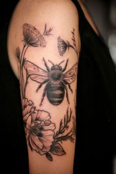 Black And Grey Bee With Flowers Tattoo On Right Half Sleeve