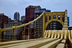 The Roberto Clemente Bridge and downtown Pittsburgh, PA. #Pittsburgh #PA #Pennsylvania #bridges #bridge #RobertoClemente  #yellow #architecture #engineering #downtown #urban #skyline #cityscape #landscape #sky #buildings #skyscrapers #suspension #cables