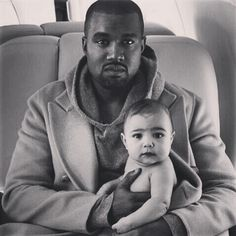121fe3d25949 Kanye West wearing the Alternative Hoodlum Hoodie with baby North in the  April 2014 issue of Vogue. Image by Annie Liebovitz.