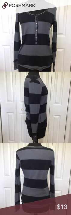 Victoria's Secret striped waffle knit top This top has long sleeves and a button tab front. In good condition without any rips or stains. Measurements taken flat and in inches. Armpit to armpit 17. Shoulder to shoulder 17. Front center to hem 171/2. Back center to hem 24. Sleeve 25. Victoria's Secret Tops