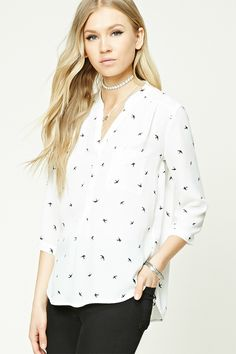 A semi-sheer woven shirt featuring an allover bird print, a split neckline, a button front, front patch pocket, 3/4 sleeves with button cuffs, and a dolphin hem.