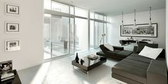 couleur salon en blanc canapé tout confort et table en noir