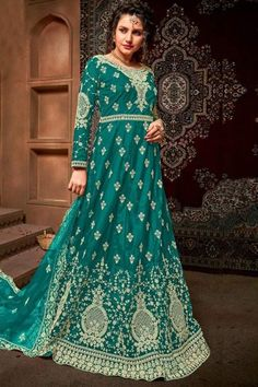 Exhibiting elegant embroidery and stitch detailing, this turquoise blue net anarkali suit which exudes feminine charm. This round neck and full sleeve party wear suit designed with zari and stone work. Completed with santoon churidar in turquoise blue color with turquoise blue net dupatta. Churidar is plain. #anarkalisuit #usa #Indianwear #Indiandresses #andaazfashion Costumes Anarkali, Anarkali Suits, Angrakha Style, Floor Length Anarkali, Indian Classical Dance, Turquoise Blue Color, Indian Salwar Kameez, Indian Dresses, Indian Wear