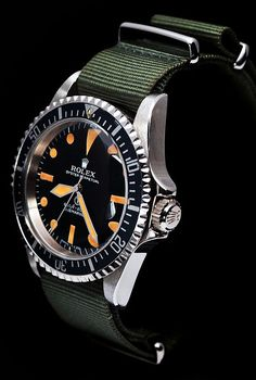 Rolex Submariner, Night Face with orange dial and a green nato strap. Dream Watches, Sport Watches, Luxury Watches, Rolex Watches, Stylish Watches, Cool Watches, Watches For Men, Vintage Rolex, Vintage Watches