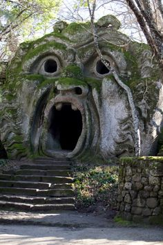 El Sacro Bosque de Bomarzo, Italy, so fun to stand inside and make scary ghost sounds while approaching tourist happen by. One of my favorite gardens and villas during my studies. Places In Italy, Oh The Places You'll Go, Places To Travel, Places To Visit, Beautiful World, Beautiful Places, Monuments, Abandoned Places, Italy Travel