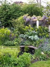Thumbnail image for Chiswick Garden in May Small Cottage Garden Ideas, Cottage Gardens, Garden Landscaping, Garden Ponds, Spring Garden, Summer Flowers, Wisteria, Topiary, Flower Beds