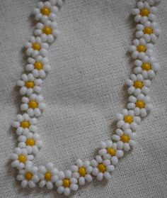 You will love this gorgeous Flower Chain Crochet Pattern and we have included an Easy Video Tutorial for you to try. Check out the ideas now.Colourful Daisy Chain necklace with magnetic clasp.This post was discovered by SeHandmade beaded bracelet and Bracelet Crafts, Seed Bead Bracelets, Seed Bead Jewelry, Bead Jewellery, Bead Crafts, Jewelry Crafts, Handmade Jewelry, Beading Projects, Beading Tutorials