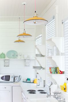 Barn Lights at Mermaid Cottages, Tybee Island beach-style-kitchen