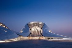 Harbin Opera House was designed by MAD Architects that has an architecture seamlessly blends with surrounding landscape to create a dramatic cultural center of the future