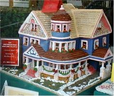 Gingerbread House Ideas: Gingerbread cuckoo clock, gumdrop trees and gummy wreaths, and the gingerbread cookie clock face with candy cane or licorice arms.