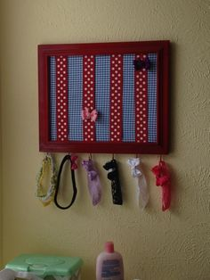 Hair accessory organizer.. love- repurpose an old picture frame.