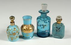 THREE SMALL VICTORIAN ENAMELED GLASS SCENT BOTTLES. Plus a similar Bristol glass vase.