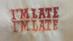 Alice in wonderland inspired / I'm late I'm late  quotes typography/ Monoprint/ free- hand stitching part of a quoted dress