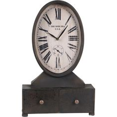 Oval mantel clock with two drawers and Roman numerals.    Product: Mantel clock Construction Material: Metal