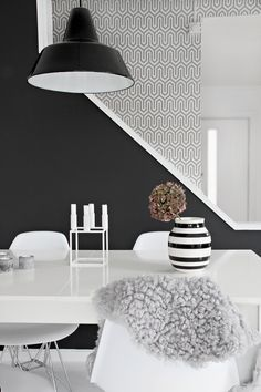 Black & white dining room with Dania wallpaper behind