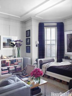 """To keep order in his small Brooklyn studio apartment, window designer Zach Motl came up with an innovative storage solution. """"Those baskets under the bed are for electrical supplies and a hammer and glue gun,"""" he says."""
