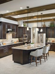 We went for dark wood kitchen designs, and the offer is diversified, so you can pick some of these according to what you wish for for your new kitchen, either built from scratch or that overdue kitchen remodel you have been saving for. Go modern, rustic or minimalist and contemporary, and your kitchen will look great according to our books but remember you have the last saying. The most important part is that among these dark wood kitchen designs you find the kitchen you have been looking… Kitchen Island With Seating, Diy Kitchen Island, Rustic Kitchen, New Kitchen, Kitchen Tips, Kitchen Decor, Backsplash With Dark Cabinets, Dark Kitchen Cabinets, Wood Cabinets