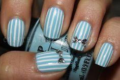 OPI's What's With the Cattitude for the base and Art Club's White striper brush for the pin stripes. For the bow, I used round and heart shaped rhinestones. Very simple and easy to do!