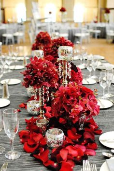 grey tablecloth and a lush bold red floral table runner