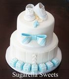 Baptism boy cake with fondant bow, cross, baby blocks and baby shoe cake topper