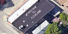 Artist Writes 'Welcome To Cleveland' On His Roof For Planes Flying Overhead. He Lives In Milwaukee.