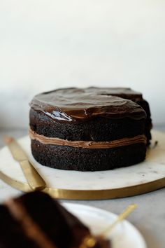 This cake is a soft and moist chocolate cake covered in decadent buttercream and a layer of silky smooth ganache. Magic Chocolate Cake, I Love Chocolate, Chocolate Truffles, Chocolate Ganache, Black Magic Chocolates, Black Magic Cake, Icing Ingredients, Cake Cover, Round Cakes