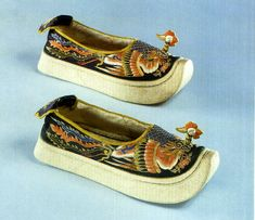 Imperial Manchu shoes, Forbidden City collection. Manchus did not bind their women's feet as the Han Chinese did in the south. Manchu women, already statuesque in height, wore towering platform shoes, embroidered with mythical birds and scrolling flora.