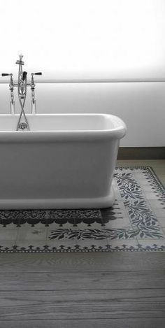 Cement tile inlay? Nice detail, though wish the design was a consistent distance from the tub all the way around.
