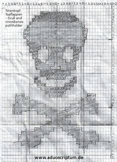 A scull and crossbones pothholder crocheted with black and white yarn.