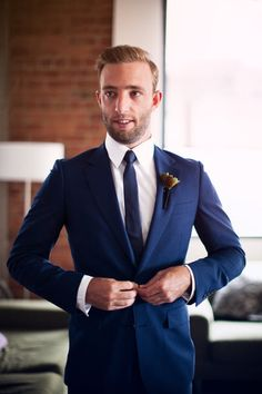 Is the blue suit back?  Here's a way for the groom to do something subtle but different for his wedding tux or suit.  He'll look 3x as sharp!
