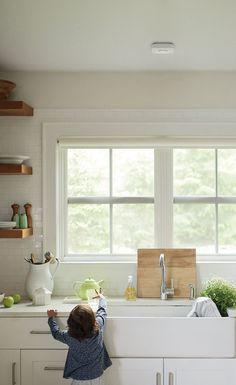 white kitchen + wood shelving